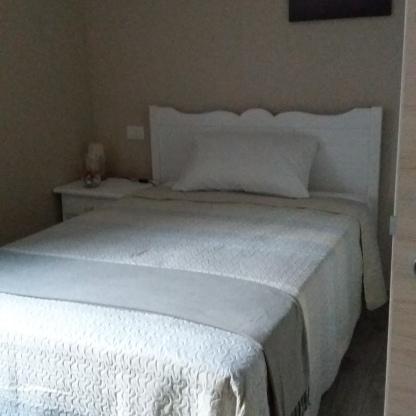 Camera singola con letto grande Reggiolacittainvisibile